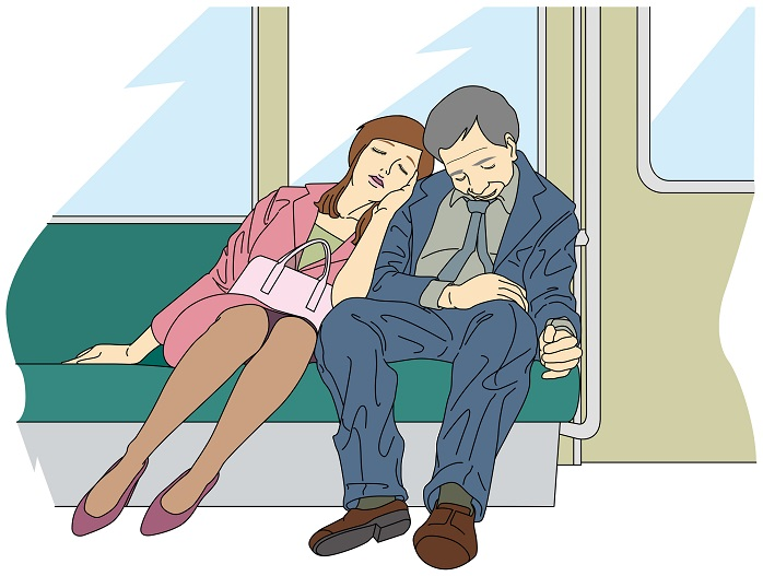 もたれ掛かる女性 電車内
